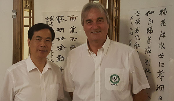 Peter Schrein (Institute for Youth Soccer) with Wang Jianxin (Director of Education in Yiwu)